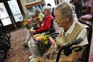 ladies holding flowers stapeley