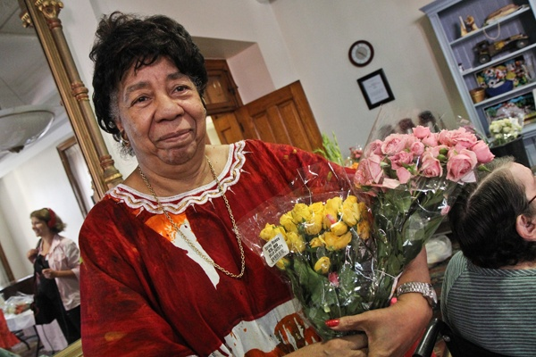angela holding 2 bouquets