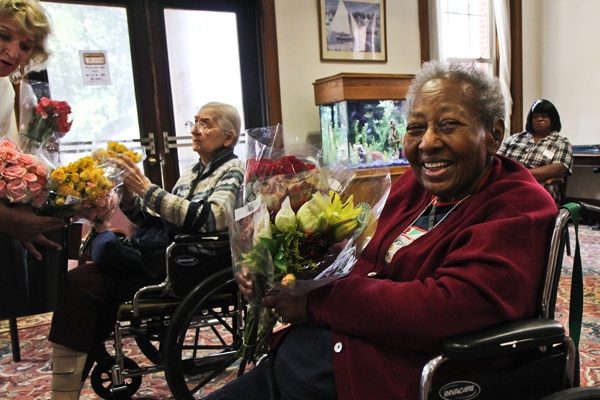 residents holding flowers stapeley