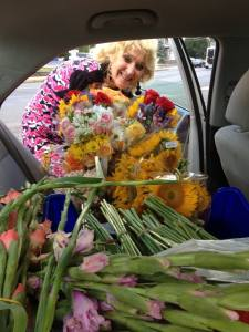 Lots of flowers in back seat of the car